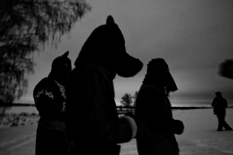 Pagan sacrificers in animal masks.